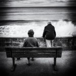 Elderly couple watch the Waves