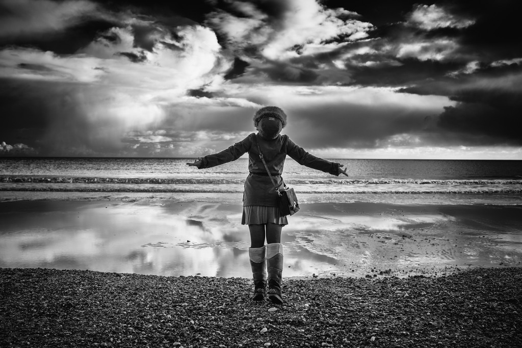 Woman looks up to the stormy heavens